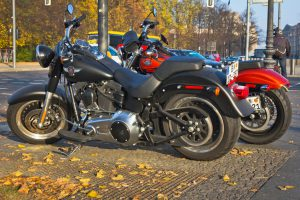 """Berlin, Germany - November 01, 2011: Two Harley Davidson motorcycles on the pavement in Berlin, Gremany. Harley Davidson is an American motorcycle manufacturer. Founded in Milwaukee, Wisconsin, during the first decade of the 20th century.The company sells heavyweight motorcycles designed for cruising on the highway."""