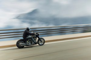 Berchtesgaden, Germany - August 21, 2015: Biker on his Harley Davidson is driving in Alps.